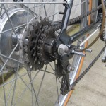 The cogs move sideways, the derailleur stays in place