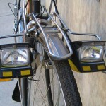 The headlights retract by flipping a handlebar mounted switch
