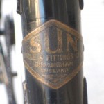 Sun Club head badge