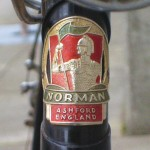 Norman head badge