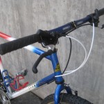 Traditional thumbshifters and a blue Controltech handlebar